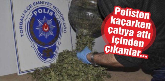 Polisten kaçarken çatıya attı içinden çıkanlar…
